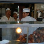 Workers behind food counter