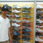 Sneakers on the wall, salesperson
