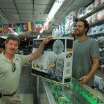 Man purchasing a floor fan inside electronics store